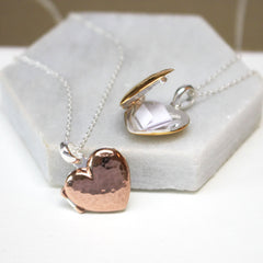 Close up of rose gold and gold Personalised Message Heart Locket Necklace