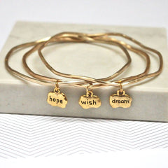 Close up of gold Hope Wish Dream Mantra Bangles set