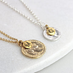Personalised coin necklace, gold and silver with initial charms
