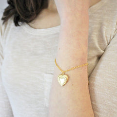 Vintage heart locket bracelet in gold worn by model
