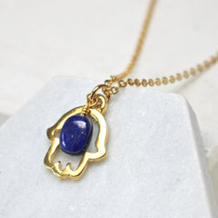 Close up of Lucky Hamsa Birthstone Charm Necklace custom pendant gold