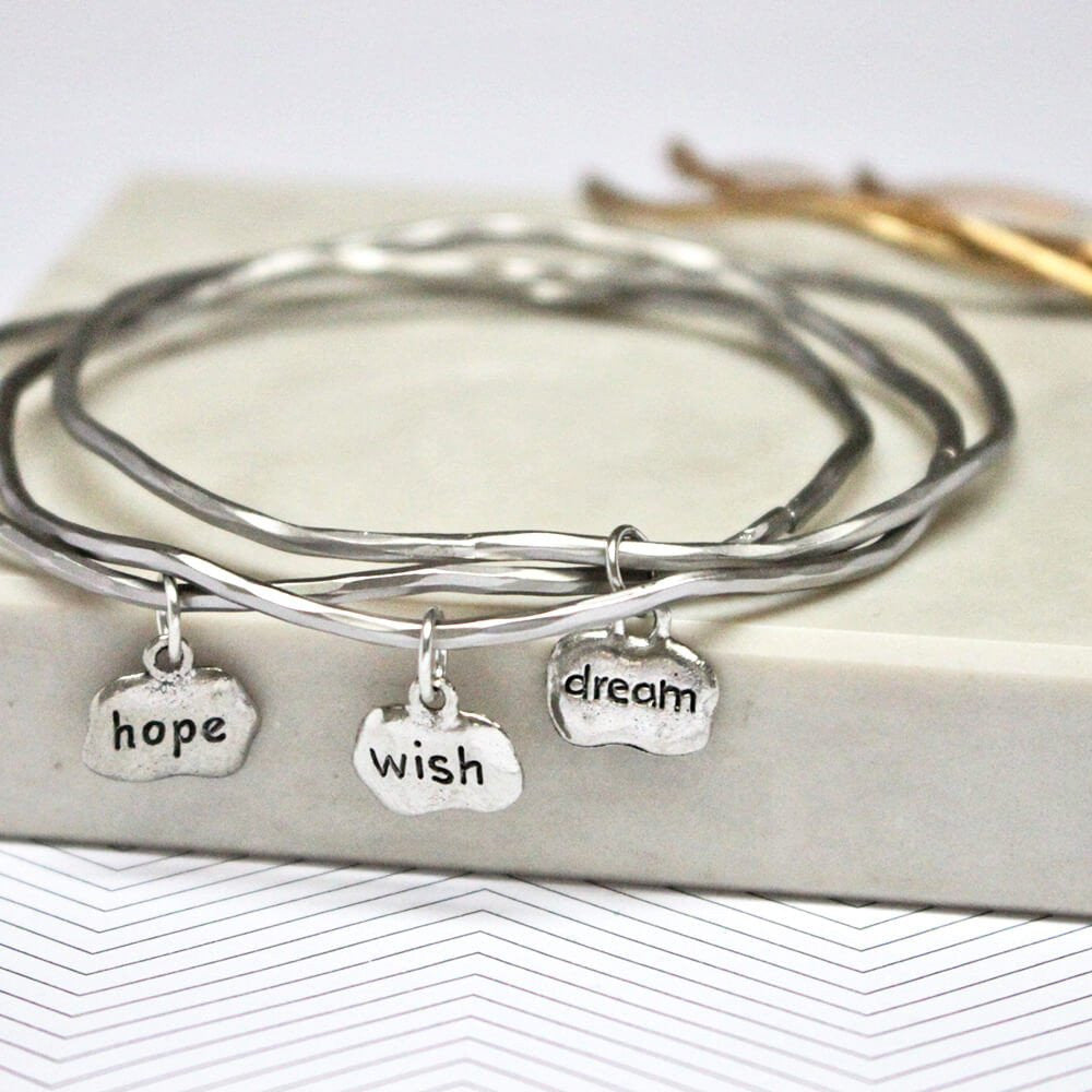 Close up of silver Hope Wish Dream Mantra Bangles set