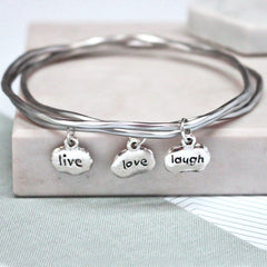 Close up of silver Live Love Laugh Mantra Bangles set