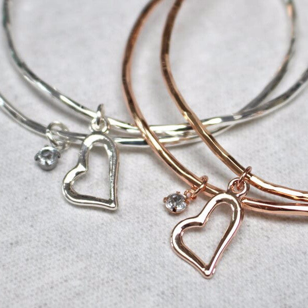 Close up of heart and diamante charm detail on love heart stacking bangle