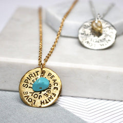 Close up of Birthstone Mantra Necklace gold