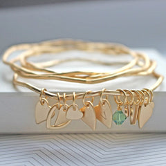 Matt gold bangle set with personalised heart charms and mint green Swarovski crystal