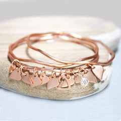 Matt rose gold bangles set with personalised heart and clear Swarovski crystal