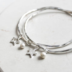 Sterling silver plated bangle with open or solid star and freshwater pearls