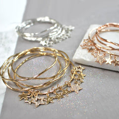 Gold, silver and rose gold bangles set with diamante star bangles