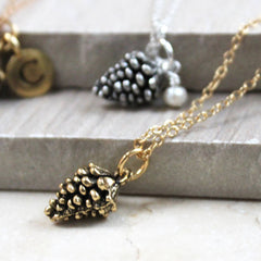close up of Pine Cone Necklace, gold