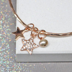Close up of rose gold bracelet with diamante star and pearl. Can be personalised for gift for her.
