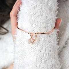 Stunning rose gold bangle worn on model's wrist