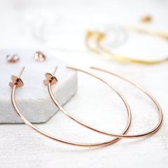 Close up of Heart Hoop Earrings rose gold