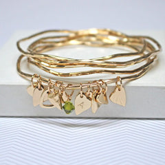 Gold bangle set with green Swarovski crystal and personalised heart charm