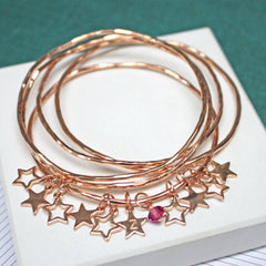 Personalised rose gold bangle set with star charms and swarovski crystals
