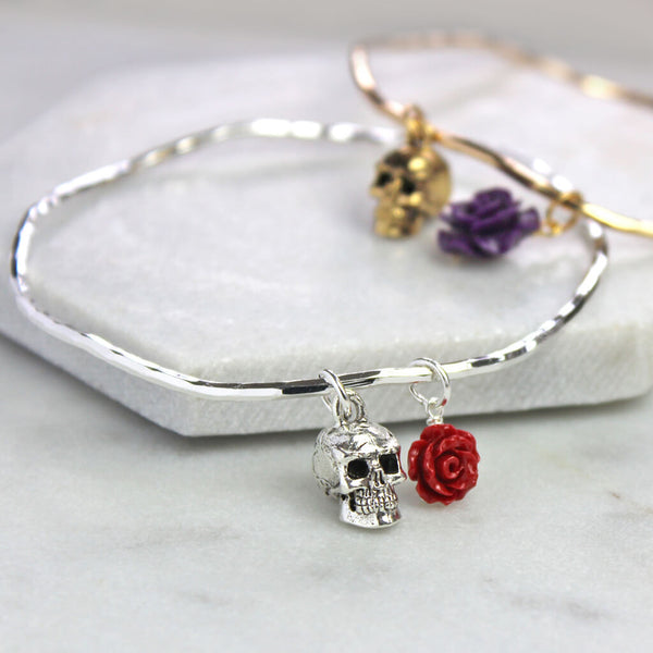 Silver and gold skull bangle with red and purple rose