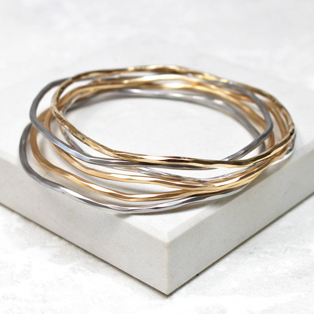 Silver and gold stacking bangles
