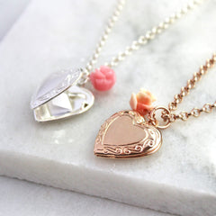 Rose gold and silver vintage heart locket necklaces sitting side by side with hidden message