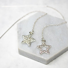 Close up of Diamante Star Thread Through Earrings silver