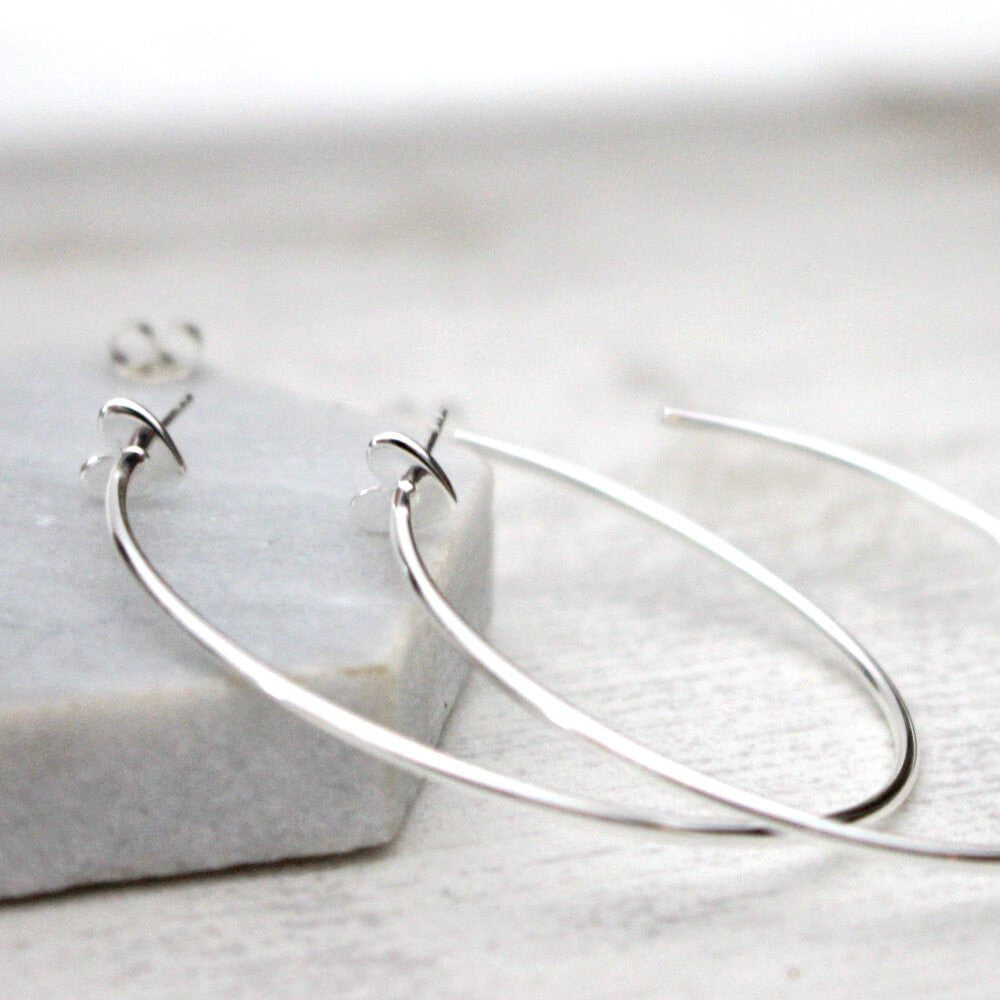 Close up of Heart Hoop Earrings silver