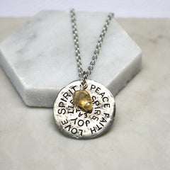 Close up of Birthstone Mantra Necklace silver