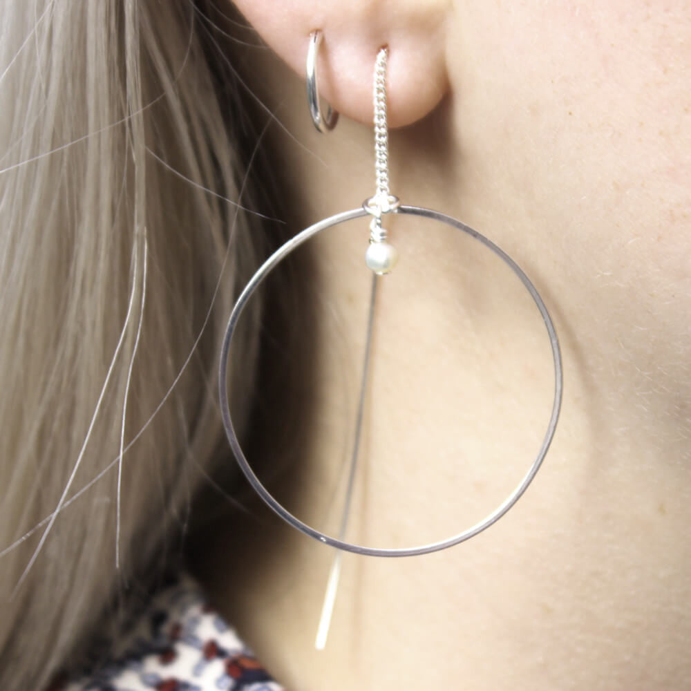 Close up of Thread Through Hoop Earrings silver