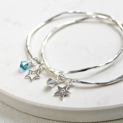 Silver personalised bangle with star charm and crystals.