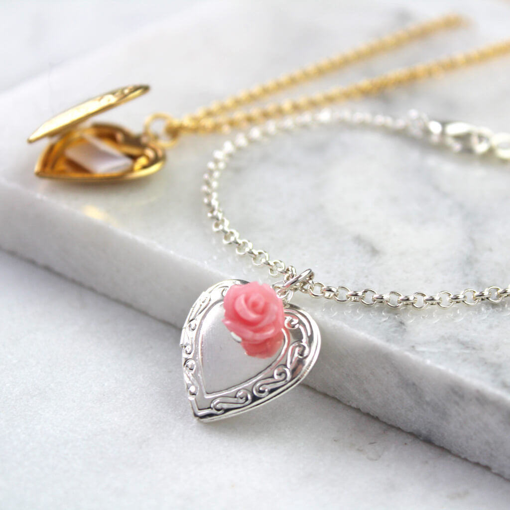 Silver vintage heart locket bracelet with rosey pink rose with gold message locket in the background