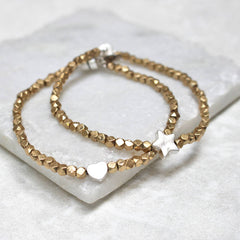 Close up of Gold Bead Charm Bracelets