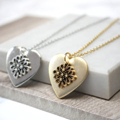 Close up of Vintage Lace Heart Pendant, gold and silver