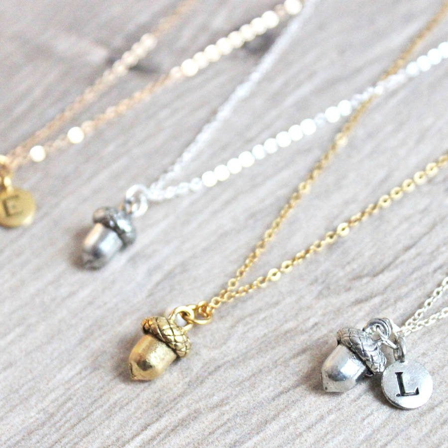 Close up of Acorn Necklace, silver with letter charm and gold
