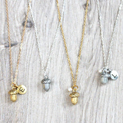Close up of personalised Acorn Necklace, silver and gold
