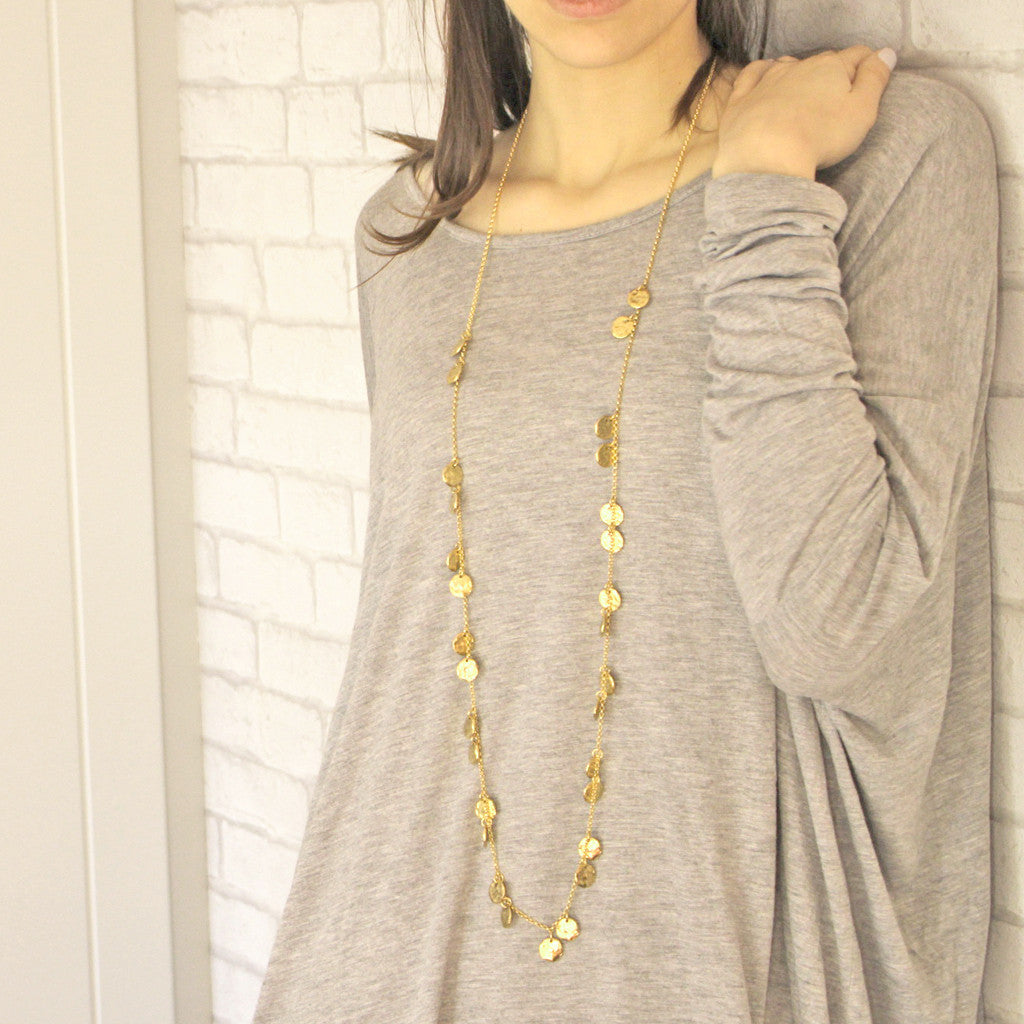 Long chains of gold necklace on model