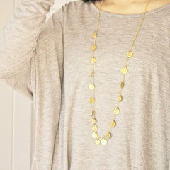 Medium chains of gold necklace on model