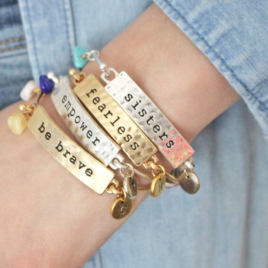 Model shot of sisters, fearless, empower and be brave mantra bangles