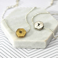Hand stamped hexagon necklace with R and T in silver and gold