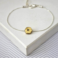 Hand stamped initial hexagon bracelet with R in gold