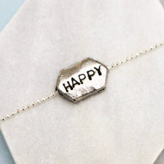 Happy hand stamped word bracelet