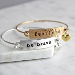 Gold fearless mantra bracelet and silver be brave mantra bracelet