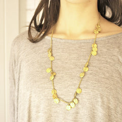 Short chains of gold necklace on model