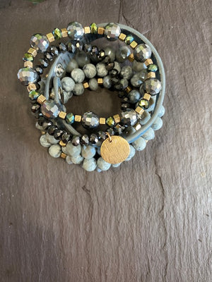 Strand Bracelet with gold coin charm