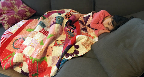 Sleeping Child with Quilt