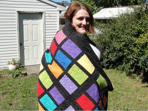 Woman wrapped in Quilt
