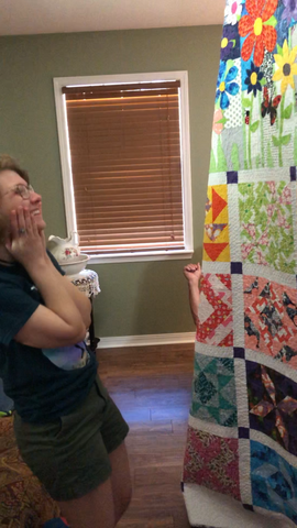 Woman viewing quilt