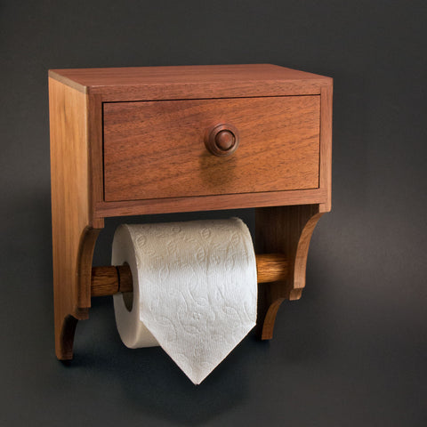 Toilet wipes and tissue holder with convenient storage drawer. Keep toilet wipes or other personal hygiene products discreetly close at hand. Made in the USA