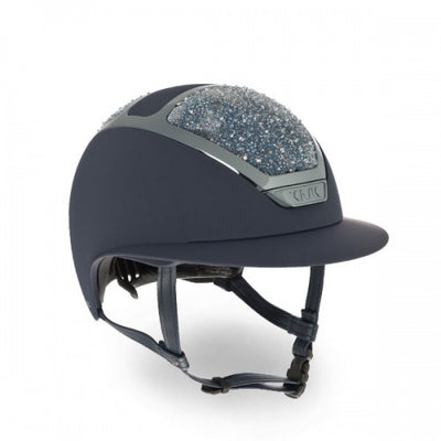 The Dogma Star Lady On The Rockss is an innovative equestrian helmet with pleasing aesthetics designed specifically for women riders.   Each one is individually handcrafted in Italy. The sparkling details can be applied on all the helmets of KASK equestrian collection.  KASK's patented self-adapting adjustment system, introduced for the first time in the equestrian market, allows the helmet to fit the rider's head perfectly and automatically by gently cradling the back of the head. It is highly popular amon