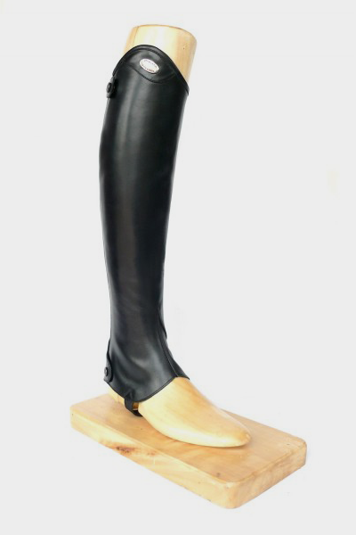 Parlanti Passion Half Chaps* are the ultimate in performance and protection.  They're available in genuine calfskin, in both black and dark brown Comes with an elastic in back for comfort and fitting Five calf sizes and two height options will provide an impeccable fit Designed to perform in tandem with our Ankle Boots, they will give you the feel of custom made boots Best for Schooling Premium calfskin interior and exterior