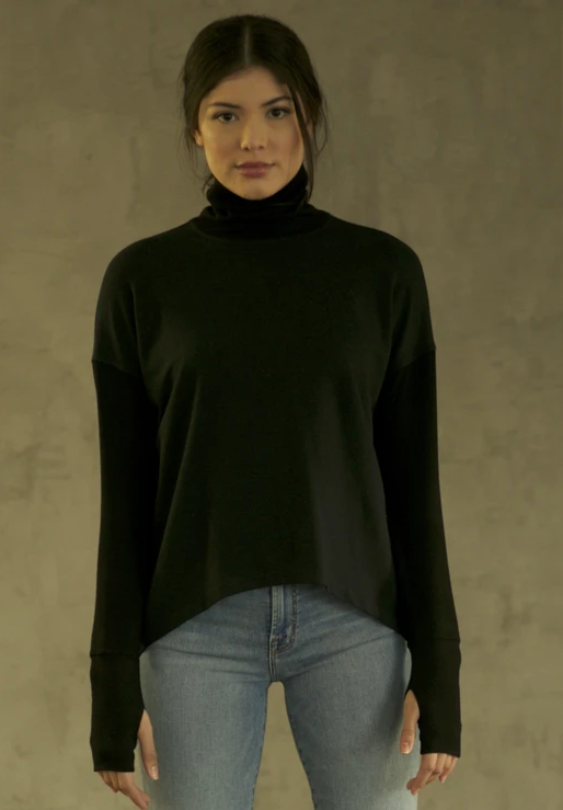 A classic go-to by T.B.E. Collection  ... An elevated everyday essential.  This turtleneck is made with lustrous ethically sourced ultra-soft bamboo.   It offers natural UV protection... and antimicrobial qualities. Wear it for a workout, to work, or a night out.   This item pairs effortlessly with our drape vests and wrap coats.   Benefits of Bamboo fabric:  Antibacterial - keeps you odor free and feeling and smelling fresh Highly sweat absorbent (Pulls moisture from skin for evaporation - moisture wicking