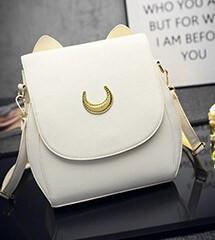 Front View of Cat Moon Leather Handbag - White on Desk