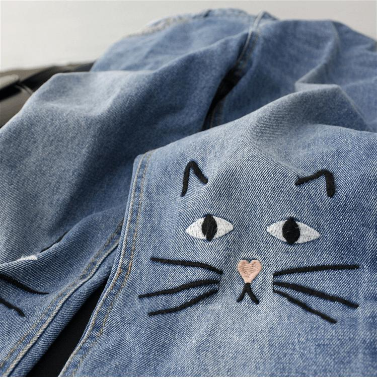 Cat Themed Jeans with Close Up on Knees